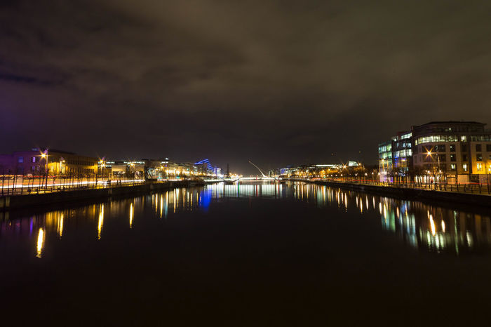 Dublin's river liffey at night, looking towards the IFSC and the Samuel Beckett Bridge. Bridge Bridge - Man Made Structure Connection Development Dublin Engineering Ifsc Ireland Liffey Mid Distance Modern Outdoors Pier Railing Reflection Residential District River Samuel Beckett Bridge Skyline Sunset Suspension Bridge Water Water Reflections Waterfront