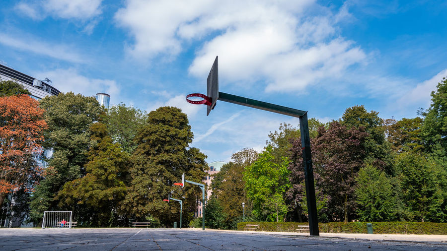 Playground Basketball Basketball - Sport Basketball Court Building Exterior Built Structure City Cloud - Sky Day Nature No People Outdoors Plant Sky Street Sunlight Tree