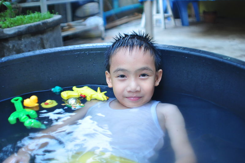 Portrait of boy in wading pool