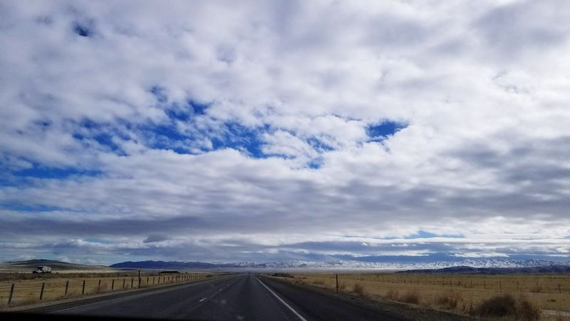 road trip Storm Cloud Long Road Ahead Homebound Snowcapped Mountain Landscape Utah Scenery Utah Beauty Road The Way Forward Cloud - Sky Transportation Highway Landscape Road Trip Day Travel Destinations Outdoors Direction Scenics Sky Beauty In Nature
