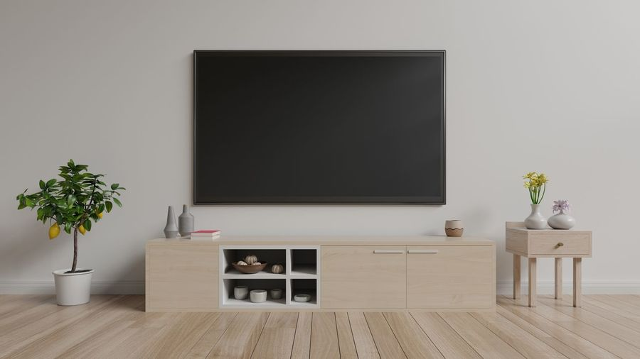 TV on cabinet in bright room,white wall background ,3D illustration Absence Domestic Room Flat Screen Flooring Furniture Hardwood Floor Home Interior Home Showcase Interior Houseplant Indoors  Living Room Modern Nature No People Plant Potted Plant Seat Table Technology Television Set Vase Wood Wood - Material