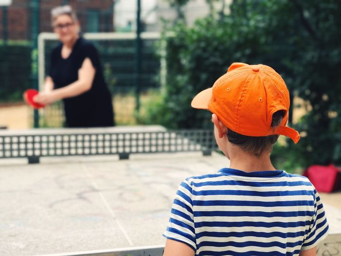 Boy playing table tennis outdoors