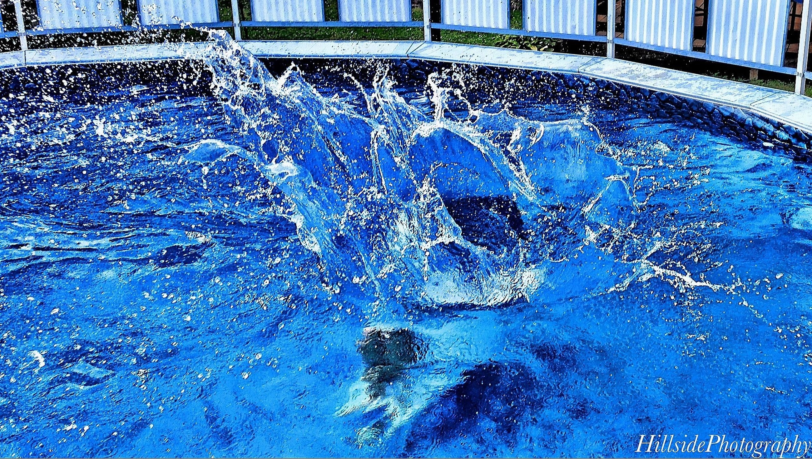 water, fountain, splashing, swimming pool, reflection, wet, built structure, architecture, building exterior, drop, motion, art, blue, spraying, art and craft, creativity, glass - material, puddle, bubble, transparent
