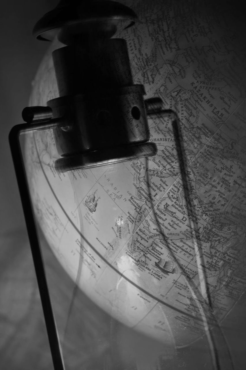 High Angle View Of Lamp Above Globe At Home