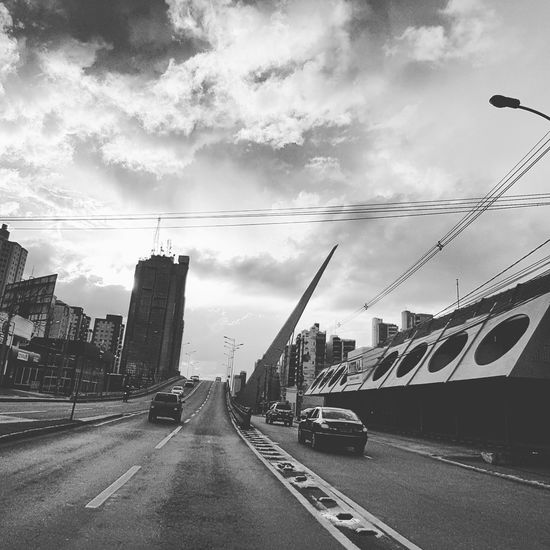 Sky Road Cloud - Sky Transportation Building Exterior City Outdoors Car Architecture Land Vehicle Bridge - Man Made Structure Day No People Cityscape Minimalist Architecture EyeEmNewHere The City Light Welcome To Black