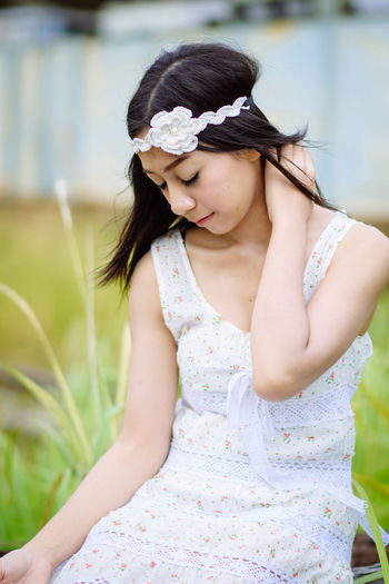 Close-up of a young woman sitting outdoors