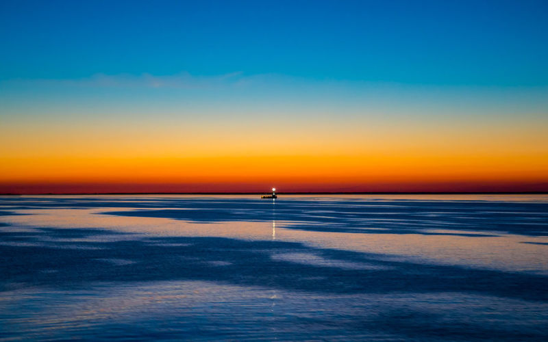Guide Beauty In Nature Clear Sky Cold Temperature Copy Space Horizon Horizon Over Water Land Nature No People Orange Color Outdoors Scenics - Nature Sea Sky Sunset Tranquil Scene Tranquility Water Winter
