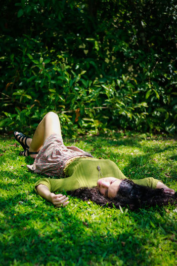 Childhood Day Field Full Length Grass Green Color Growth Lying Down Mammal Nature One Person Outdoors People Real People Relaxation Sleeping Tree Young Adult Young Women