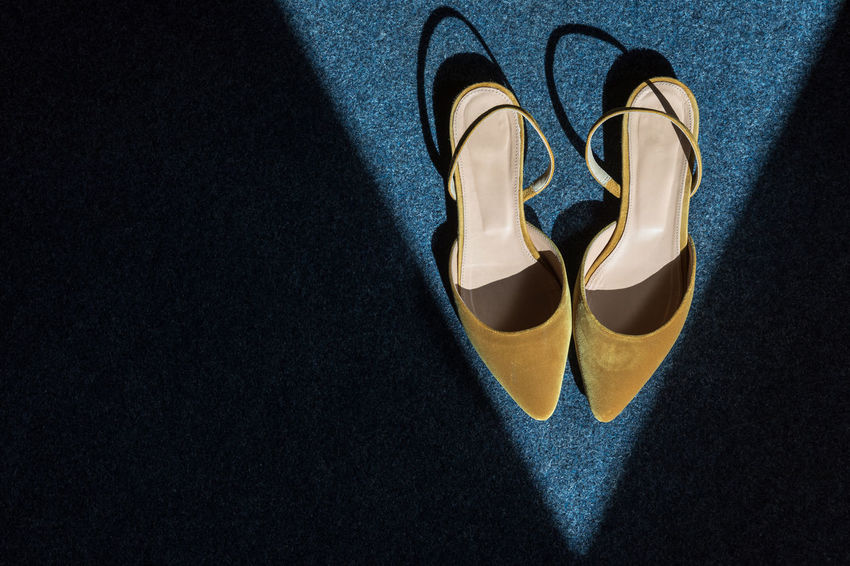 Yellow velvet shoes inside triangle sunlight spot on blue carpet (next morning after party) Elégance Leather Blue Carpet - Decor Close-up Copy Space Day Directly Above Fashion Geometric Shape High Angle View High Heels Indoors  No People Pair Pattern Shadow Shoe Still Life Sunlight Textured  Triangle Shape Two Objects Velvet Yellow