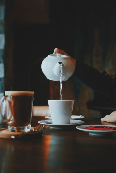 Cafe Cappuccino Close-up Coffee - Drink Coffee Cup Cup Day Drink Food Food And Drink Freshness Frothy Drink Human Hand Indoors  One Person Refreshment Saucer Table