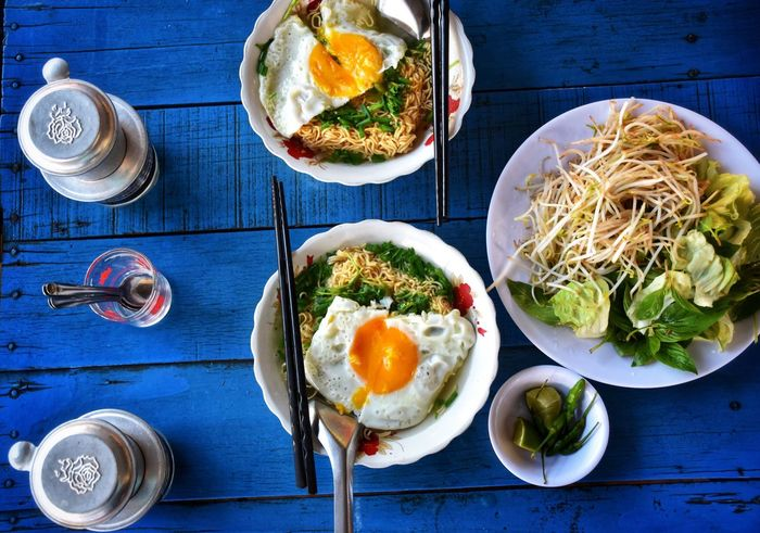 breakfast Viet Nam Vietnamese Food Vietnamese Breakfast Breakfast ♥ Breakfast Time Noodles Coffee Black Coffee Blue Blue Table Food And Drink Food Healthy Eating Freshness Wellbeing Ready-to-eat Meal Plate Table Directly Above Vegetable No People Indoors  High Angle View Egg Bowl Still Life Fork Household Equipment