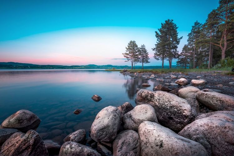 Blue hour in Norway Pebble Beach Pebble Rocky Coastline Calm Pastel Colored