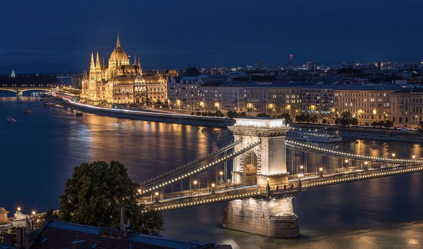 Golden gate bridge over river at night