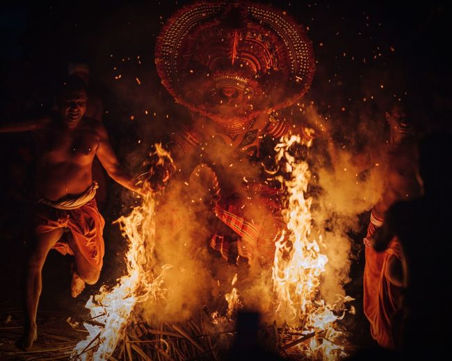 Theyyam of Kannur - Kerala Asian  ASIA Indian Culture  Travelphotography Travelling Travel Photography Travel Destinations Travel Fire Kerala The Gods Own Country ;) Kerala India Kerala India Theyyams Of Kannur Theyyam Burning Fire Night Motion Flame Fire - Natural Phenomenon Event Celebration Heat - Temperature Arts Culture And Entertainment Glowing Real People Performance Blurred Motion Exploding