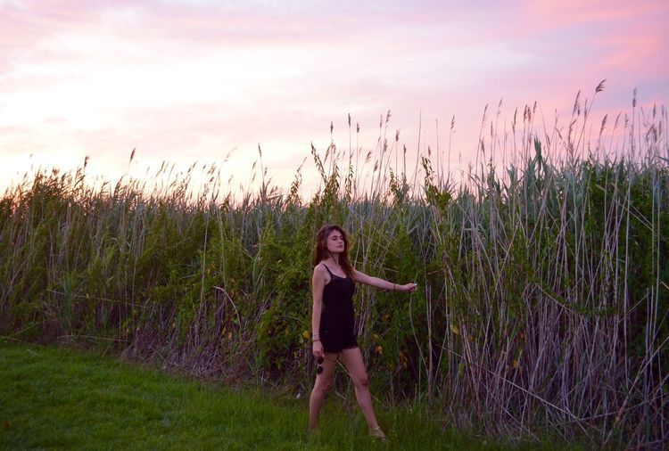 Plant Field Grass Young Adult One Person Standing Leisure Activity Sky Growth Nature Real People Full Length Land Lifestyles Front View Casual Clothing Young Women Looking At Camera Fashion Outdoors Beautiful Woman Ocean City Sunset Brunette Field Photographer Nature Photography Model Modeling Sunset_collection Ocean City Md Brunette Girl