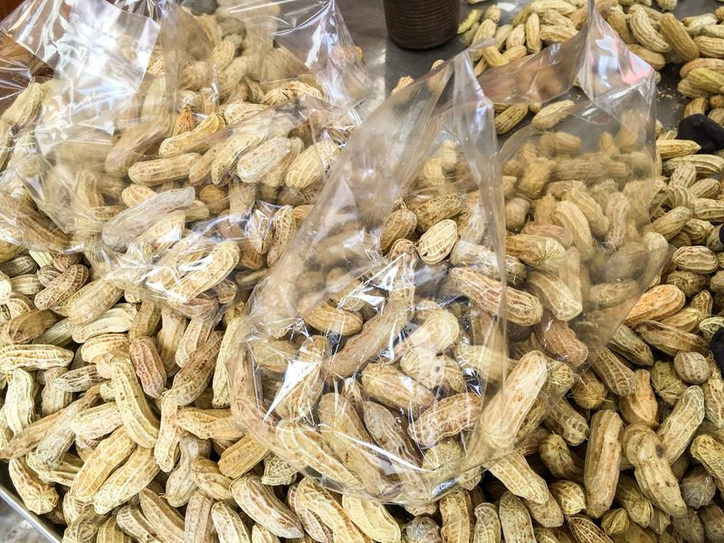 boiled peanuts in Thai market Arachis Hypogaea Peanuts Snack Bean Close-up Delicious Food Food And Drink For Sale Freshness Groundnuts Healthy Eating Large Group Of Objects Market Market Stall No People Nutshell Outdoors Retail  Supermarket
