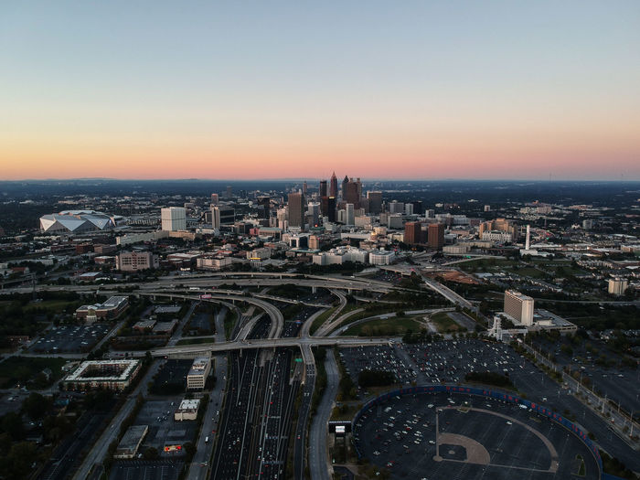 Drone  Aerial View Architecture Atlanta Building Exterior Built Structure City Cityscape Crowded Day Drone Photography High Angle View Modern Outdoors Sky Skyscraper Sunset Travel Destinations Urban Skyline