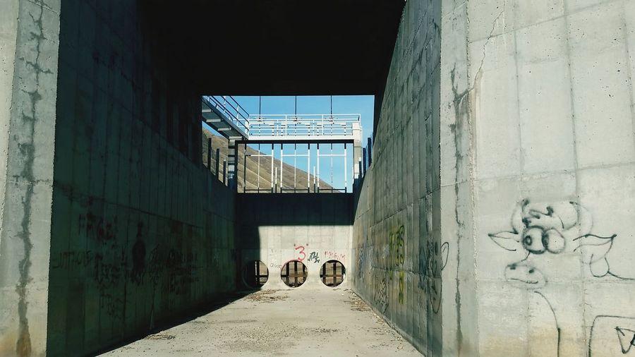 Long Empty Pathway Along Walls