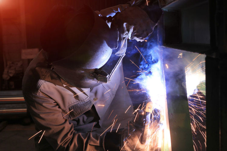 Industrial worker Welding and bright job Construction Gas Industrial Industry Light Smoke Welding Work Worker Factory Fire Flash Job Manufacture Manufacturing Mask Men Metal Protection Safety Skill  Sparks Steel Structure Welder