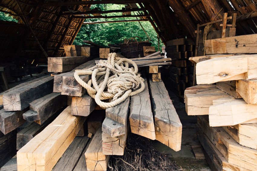 Carpentry Work Rope Architecture Art And Craft Built Structure Carpentry Close-up Day Focus On Foreground Lumber Industry Lumber Mill Nature No People Outdoors Rope Stock Sunlight Tied Up Tree Wood Wood - Material Wood Pile Wood Stock