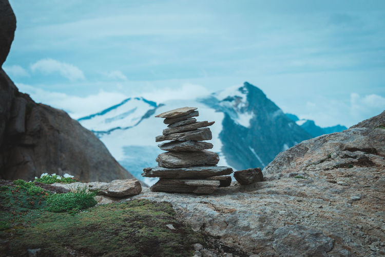 Stack of rocks in mountains against sky