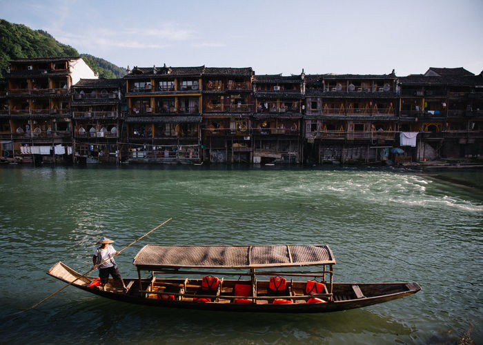 The Ancient Phoenix City of Fenghuang, China Ancient Architecture Boat Built_Structure Canal Canals Chinese Chinese Food Classic Cruise Gondola Leisure Activity Lifestyles Movement Orient Oriental Outdoors Pagoda River Riverside Rowing Tourism Town Village Water The Street Photographer - 2017 EyeEm Awards The Photojournalist - 2017 EyeEm Awards Let's Go. Together.