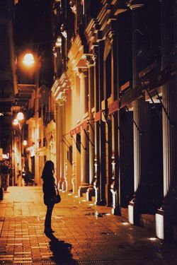 It felt as if the whole world was a long Friday afternoon. Nothing to do, nowhere to go. Night Nightphotography Streetphotography Architecture One Person Illuminated Building Exterior Night Built Structure Real People Full Length City Street Women Outdoors Warm Clothing Walking