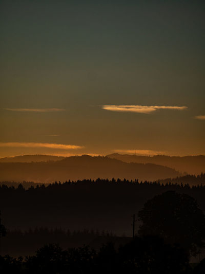 Beauty In Nature Cloud - Sky Environment Fog Hazy  Idyllic Landscape Nature No People Non-urban Scene Orange Color Outdoors Plant Scenics - Nature Silhouette Sky Sunset Tranquil Scene Tranquility Tree