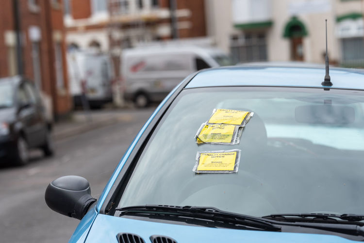 Penalty Charge Notice on Car Windscreen parked on British road in England Architecture Built Structure Car City Close-up Communication Day Focus On Foreground Land Vehicle Mode Of Transportation Motor Vehicle No People Notice Outdoors Parking Penalty Road Stationary Street Text Ticket Transportation Windscreen Yellow