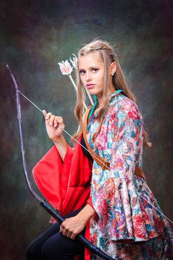 Portrait Of Young Woman Holding Archery Bow