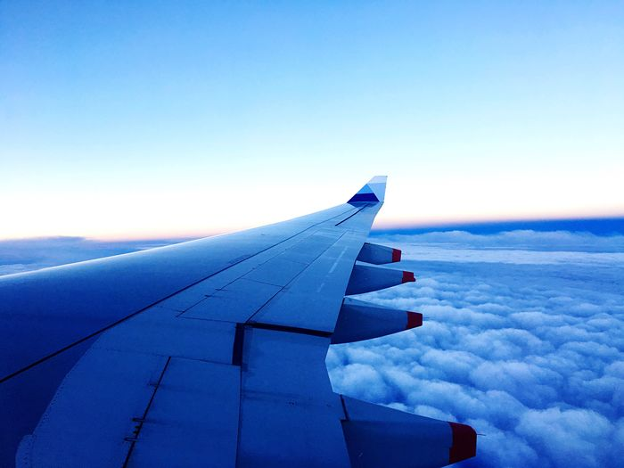 Airplane Aircraft Wing Sky Flying Blue Travel Transportation Aerial View Nature Cloud - Sky Cloudscape Scenics No People Airplane Wing Outdoors Journey Landscape Air Vehicle Day Beauty In Nature