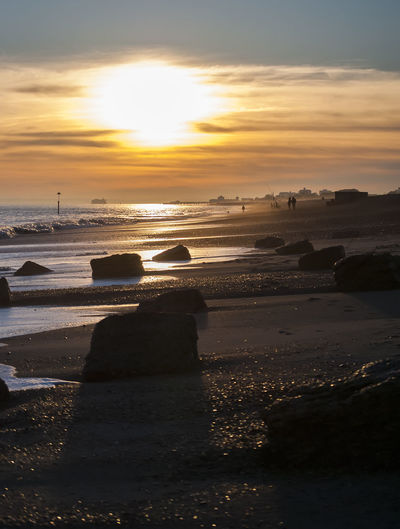 Eastney Sunset Eastney Beach Southsea Hampshire  England Sunset Pebble Waves Rocks Water Sea Sunset Beach Shadow Low Tide Sunlight Astronomy Sun Sky