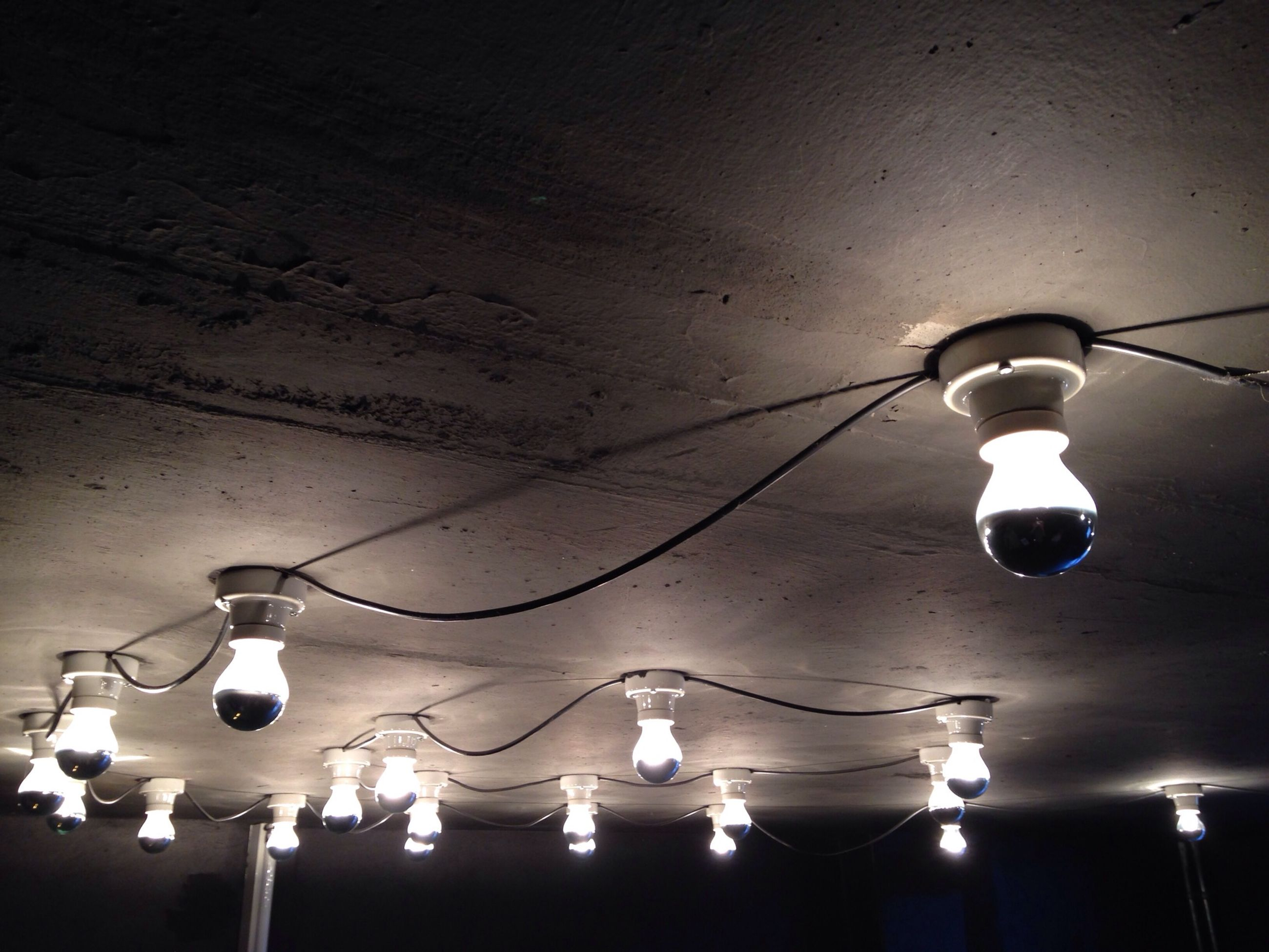 lighting equipment, illuminated, low angle view, electricity, hanging, ceiling, electric light, indoors, electric lamp, light bulb, street light, decoration, lamp, chandelier, night, light - natural phenomenon, lantern, glowing, lit, no people