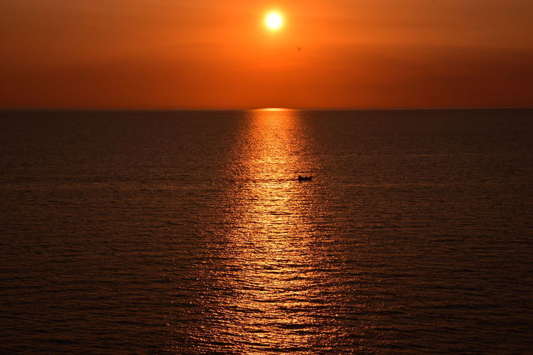 Sunset Sea Orange Color Sun Reflection Water Horizon Over Water Vacations Sunlight Sculpted By Light Scolpire Con La Luce Summer Memories 🌄 Summer Views Nikon D7200 Reddish Orange Golden Light Thepuristnofilternoedit Sunlight Silhouette Tranquility Scenics Salento Puglia Italy Holidays The Week On EyeEm Summer Exploratorium