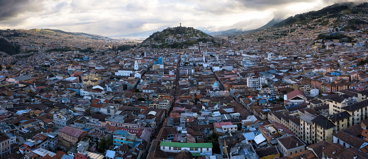 Aerial view of the city of Quito, Ecuador. At the center is the Panecillo Hill, where the statue of the Virgin Mary is located. Virgen De Legarda Downtown Afternoon Travel Destinations Dronephotography Southamerica Hill Panecillo Settlement Outdoors Environment Town TOWNSCAPE Nature Community Day High Angle View Building Mountain Cityscape Residential District Sky Cloud - Sky City Crowded Crowd Built Structure Building Exterior Architecture Panoramic Composite Image Old Buildings Colonial Architecture