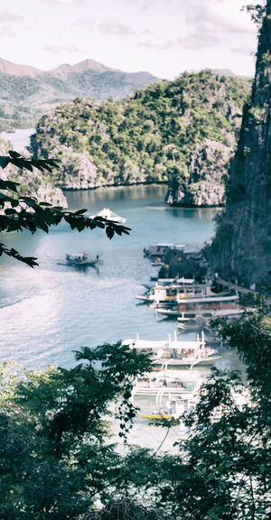 High angle view of boats in lake against sky