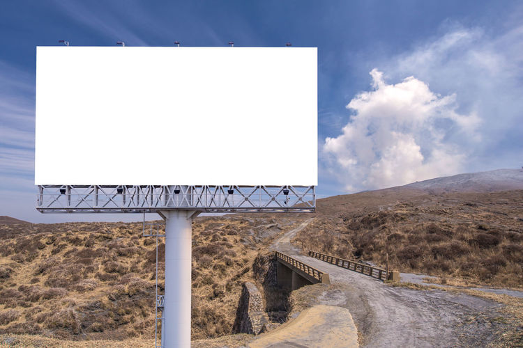 Advertisement Billboard Blank Cloud - Sky Communication Copy Space Day Environment Land Landscape Mountain Nature No People Outdoors Placard Road Sign Sky Transportation White Color