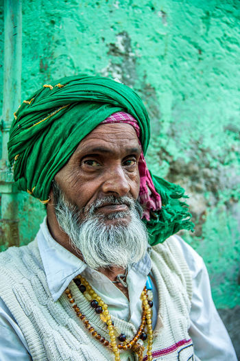 Green Turban The walls leading to the mosque in Sambhar city, on the namesake lake near Jaipur are appropriately green, the color of Islam. Green is also the turban of this older gentlemen, follower of one of the many religions present in India. Green Color India Indian Jaipur Travel Photography Beard Candid Islam Muslim One Person Portrait Rajasthan Real People Sambhar Senior Adult Senior Men Travelphotography Turban White Beard