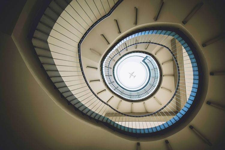 Directly below view of spiral staircase in building
