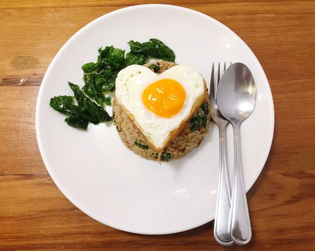 Rice topped with stir-fried pork and basil and heart egg Thai Food Thailand Ready-to-eat Food Egg Plate Food And Drink Healthy Eating Table Fried Egg Meal