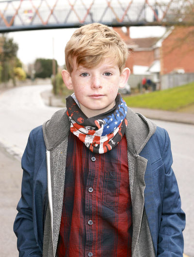 Portrait of boy. Young Boys Casual Clothing Child Childhood Clothing Day Focus On Foreground Front View Innocence Lifestyles Looking At Camera Males  One Person Outdoors Portrait Real People Scarf Standing Waist Up