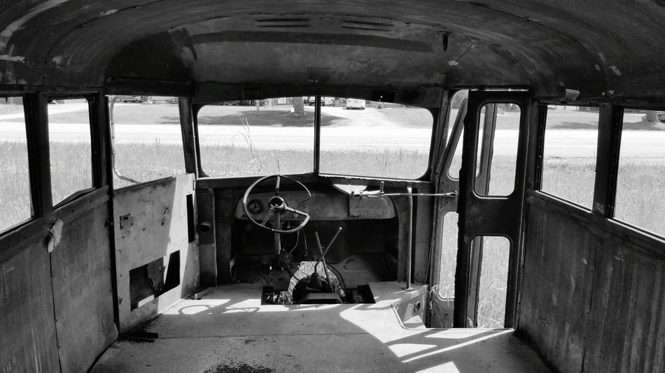Taking Photos Door School Bus Neglected Derelict Derelict & Abandoned Blackandwhite Black And White Black & White Old Bus Old School Bus Old Abandoned & Derelict Forgotten Left Behind Bus Inside Abandoned Abused Overgrown Steering Wheel Doorway