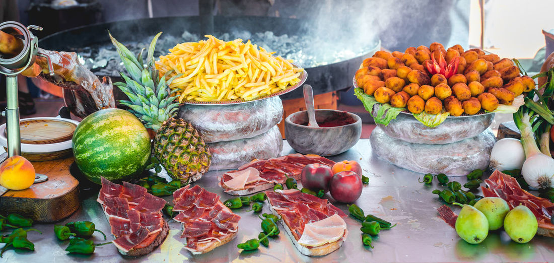 Delicious tasty street food at a market in Spain. Cooking Cuisine Food And Drink Ham Market Travel Vegetables & Fruits Bread Croquette Food Fresh Fruits Gourmet Grill Grilled Healthy Iberic Ham Meat Organic Food Restaurant Shop Street Street Food Traditional Vegetables