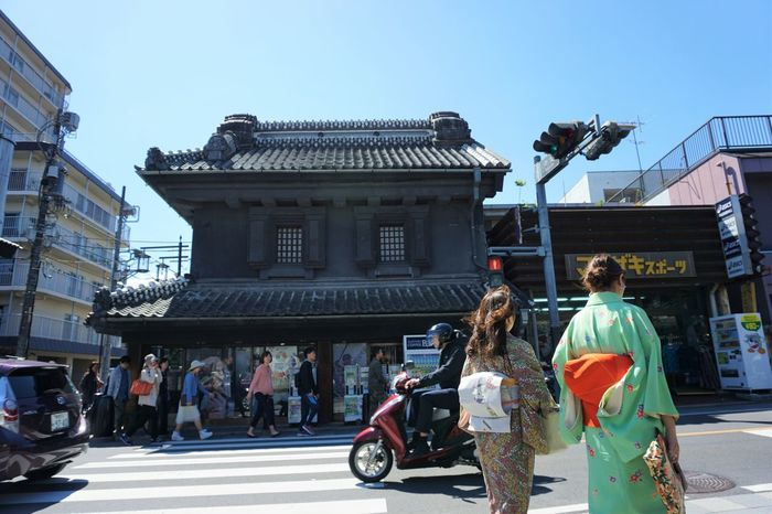 old storehouse merchant houses at Koedoe Kawagoe Architecture Building Exterior Built Structure City City Life Clear Sky Day Edo Period Full Length KAWAGOE Leisure Activity Lifestyles Men Outdoors People And Places Person Retail  Storehouse Street Temple - Building Transportation