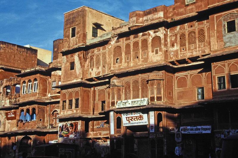 A typical street in Jaipur, India A Taste Of India Indian Writing Jaipur Rajasthan Shops In Jaipur The Pink City Architecture Building Exterior Built Structure City Day History Large Group Of People Low Angle View Men Outdoors Pink Brick Pink City Jaipur Real People Sky Travel Destinations