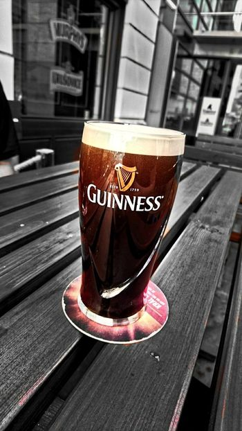 Drink Wood - Material Food And Drink No People Outdoors Frothy Drink Guiness Guiness Beer XperiaZ5 XPERIA First Eyeem Photo Sony Xperia Photography. Xperia Z5 Xperiaphotography Day Beer Time Beer Glass Guinessbeer