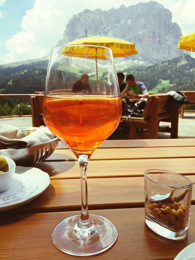 43 Golden Moments Golden Drink Glass Mountain View Sky And Clouds Umbrellas Outdoor Tourists Relaxing Tranquil Scene People Restaurant Chalet Mountains And Valleys Travel Destination Beautiful Nature Holidays Tranquility Sassolungo UNESCO World Heritage Site Beauty Of Nature