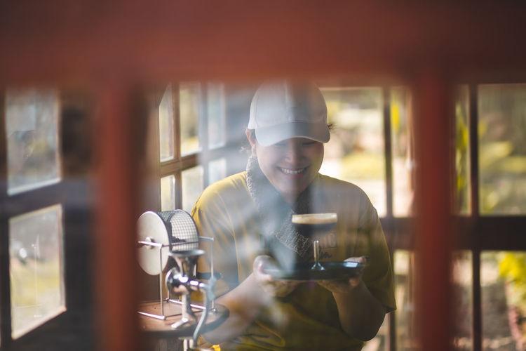 Man holding glass of restaurant