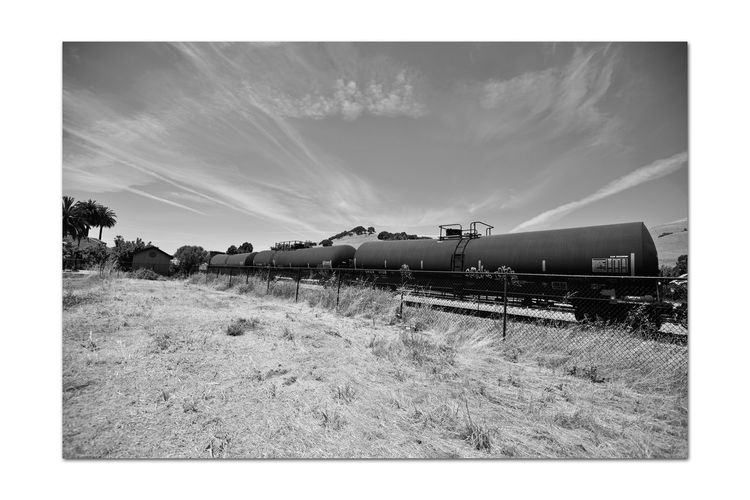 Freight Train 7 Union Pacific Railroad Passes Through Niles Canyon Freight Train Intermodal Freight Transport Tankers Tank Cars Train Railroad Tracks Train_Photography Railroad Photography Cargo Rolling Stock Monochrome Monochrome_Photography Sky And Clouds Landscape Eastbay Hills Trees Building Fence Black & White Black & White Photography Black And White Black And White Collection  Dry Grasses Landscape_Collection Landscape_photography Train - Vehicle Railroad Car Countryside