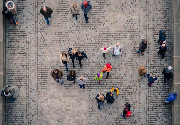 High angle view of people walking on bridge